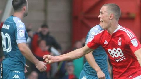 Thomas Lam celebrates a goal for Nottingham Forest
