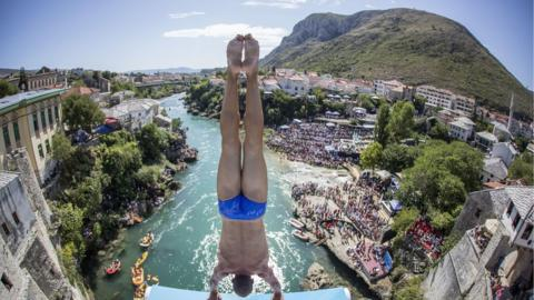 Michal Navratil prepares to dive from the the Stari Most bridge during the Red Bull Cliff Diving World Series