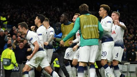 Tottenham's players celebrate scoring against Manchester City in the Champions League