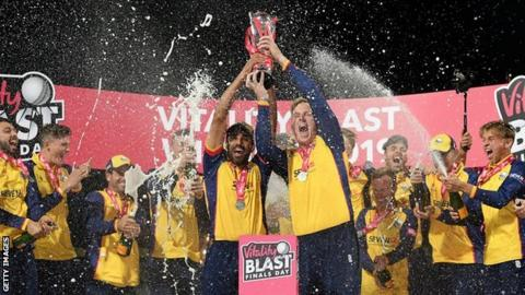 Ravi Bopara and Simon Harmer lift the T20 Blast trophy aloft after Essex's win over Worcestershire