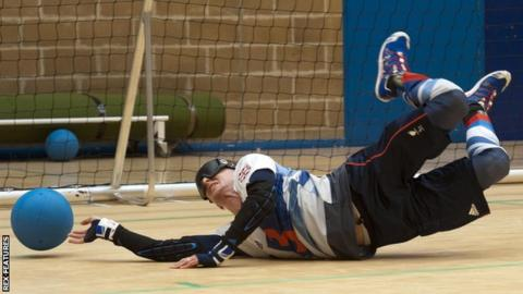 GB goalball player Michael Sharkey lunges to stop the ball