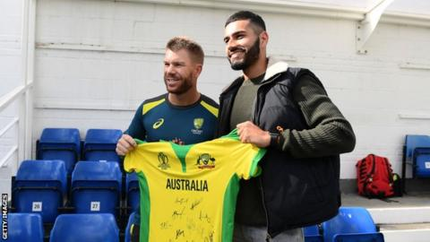 David Warner hands Jaykishan Plaha a signed Australia shirt