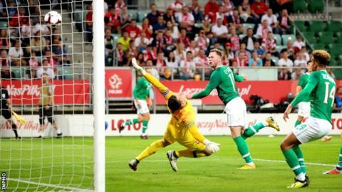 Aidan O'Brien's header beats Poland keeper Wojciech Szczesny in Wroclaw
