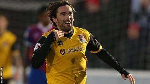 Ricky Holmes celebrates his winner for Northampton