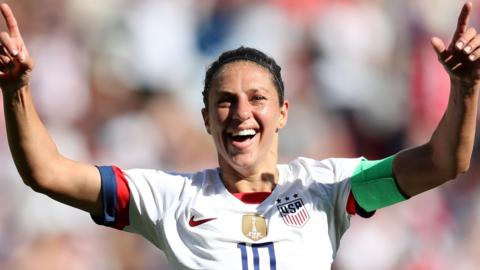 Carli Lloyd celebrates scoring against Chile at the Women's World Cup