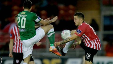 Cork midfielder Billy Dennehy challenges Derry's Rob Cornwall