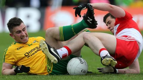 Donegal's Paddy McBrearty tangles with Derry opponent Dermot McBride during the Ulster Senior Football semi-final at Clones