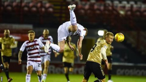 Hamilton's Brian Easton lands awkwardly against Aberdeen