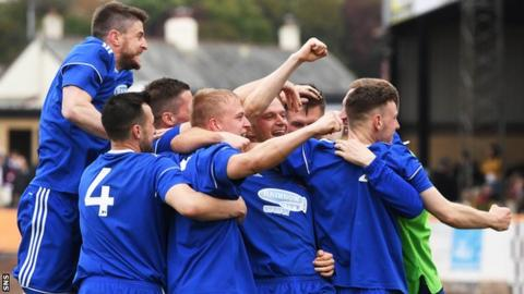 Cove celebrate after Jordon Brown scores Cove's sixth goal of the tie
