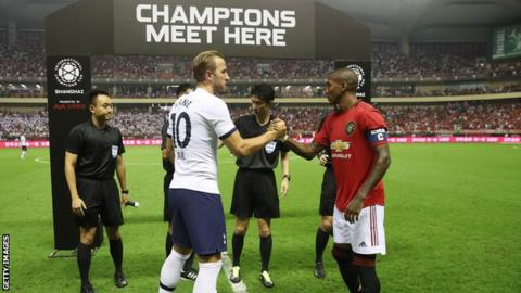 Harry Kane shakes hands with Ashley Young before Tottenham's International Champions Cup match against Manchester United in Shanghai in July 2019