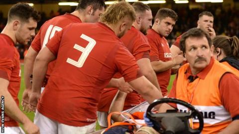 Ellis Jenkins is consoled by his Wales team-mates