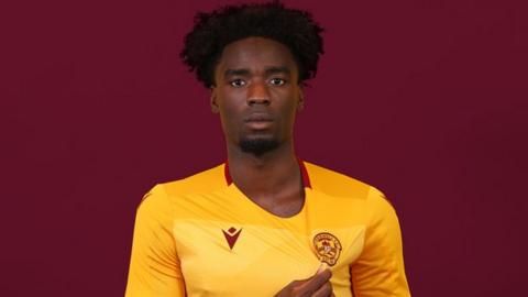 Motherwell make son of former Manchester United and England striker their seventh signing.