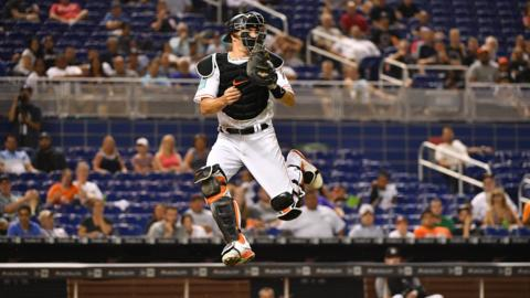 Miami, United States, 23 July: JT Realmuto of the Miami Marlins attempts to catch a throw from the outfield during the seventh inning of their match against the Atlanta Braves at Marlins Park. (Photo by Mark Brown/Getty Images)