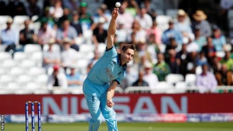 Chris Woakes bowling for England