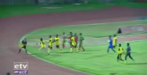 Welwalo Adigrat University chase down the referee after he awards a goal to opponents Defence