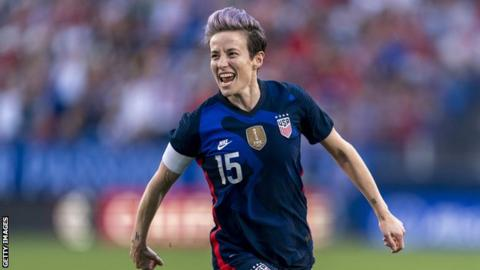 donald trump news Megan Rapinoe celebrates