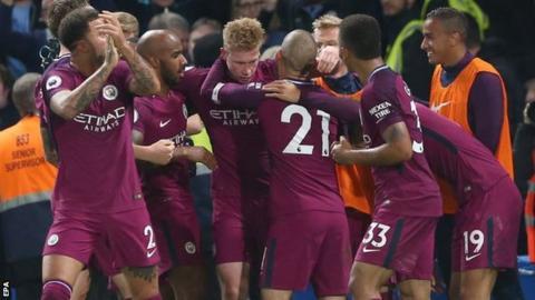 Manchester City celebrate scoring at Chelsea
