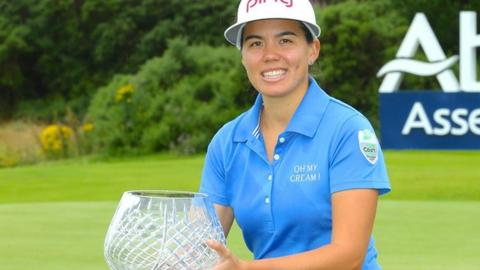 Isabelle Boineau celebrates with the Scottish Open trophy