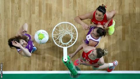 Kelly Morgan and Nia Jones of Wales and Bethan Goodwin and Lynsey Gallagher of Scotland contest the ball at the 2018 Commonwealth Games