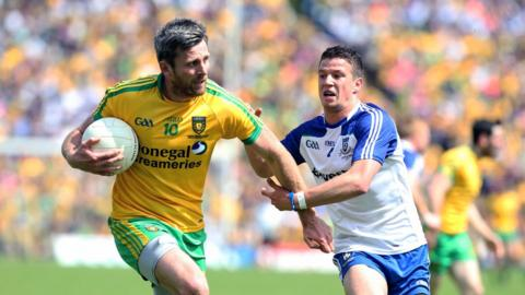 Donegal's Christy Toye shrugs off the attention of Monaghan's Ryan Wylie at Clones