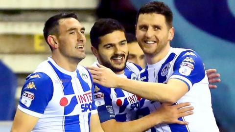 Wigan celebrate taking the lead against Bournemouth in the FA Cup