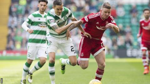 Celtic's Mikael Lustig and Aberdeen's Jonny Hayes race for the ball