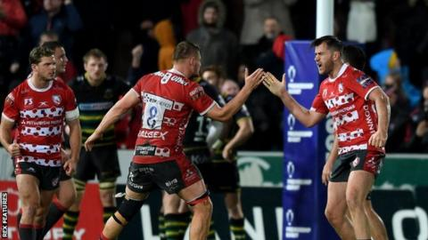 Gloucester players celebrate their win over Northampton