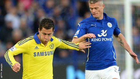 Paul Konchesky (right) keeps tabs on Chelsea's Eden Hazard