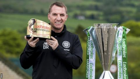 Brendan Rodgers with the league sponsor's manager of the year award and Scottish Premiership trophy