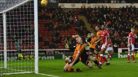 Diogo Jota slides in but clears the Barnsley crossbar from close range