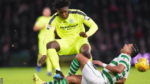 Hibs' Darnell Johnson fouls Celtic's Emilio Izaguirre, who was taken off injured