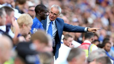 Claudio Ranieri gives instruction to N'Golo Kante as he prepares to come on as a sub during a match with Sunderland.