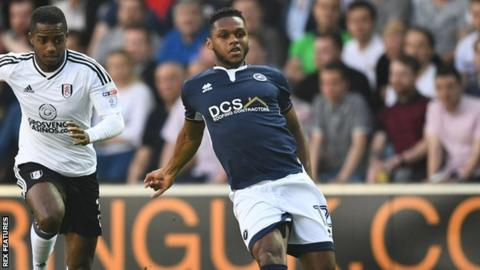 Mahlon Romeo of Millwall is pursued by Fulham winger Ryan Sessegnon