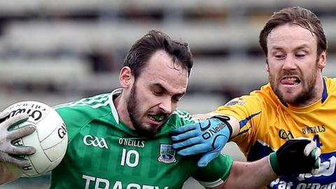 Fermanagh's Paul McCusker in action against John Hayes of Clare
