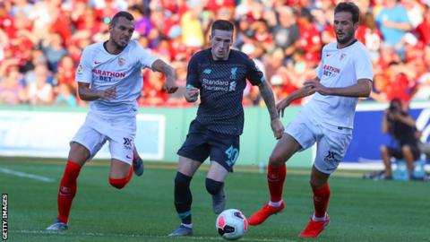 Ryan Kent (centre) in action for Liverpool against Sevilla