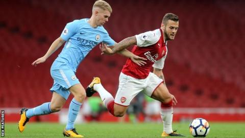 Jacob Davenport in action for Manchester City against Arsenal's Jack Wilshere