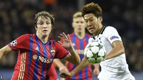 Son Heung-Min (right) vies with Mario Fernandes