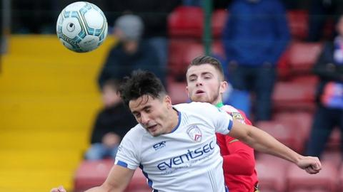 Coleraine's Aaron Traynor and Rory Donnelly of Cliftonville in aerial action