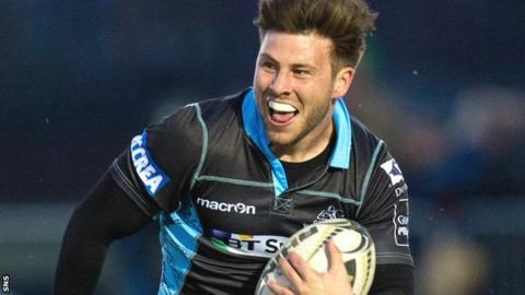 Glasgow scrum-half Ali Price runs with the ball against Zebre