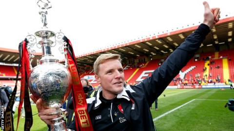Eddie Howe lifts the Championship title with Bournemouth in 2015