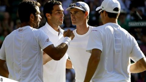 Jean-Julien Rojer of the Netherlands, left, and Horia Tecau of Romania, second left, win the men's doubles final against Jamie Murray of Britain and John Peers of Australia
