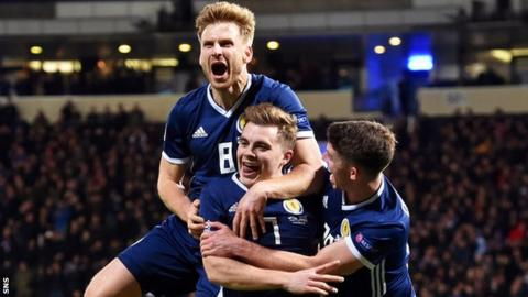 Scotland's Stuart Armstrong, James Forrest and Ryan Christie celebrate