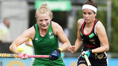 Ireland's Hannah Matthews is challenged by Pia-Sophie Oldhafer in Tuesday's defeat by Germany