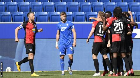 Hertha Berlin players celebrate their opening goal in the win over Hoffenheim