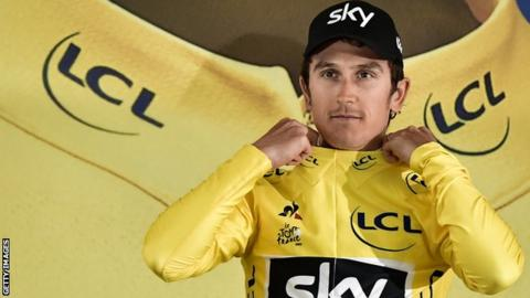 Geraint Thomas pulls on the yellow jersey after stage one of the 2017 Tour de France