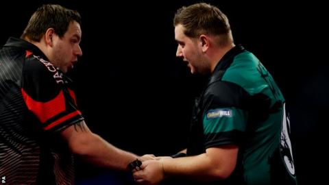 Adrian Lewis congratulates Kevin Munch after losing in the first round of the PDC World Championship