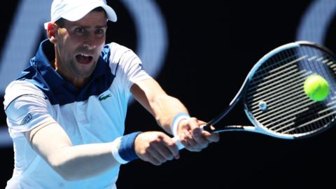 Novak Djokovic playing against Donald Young in the Australian Open