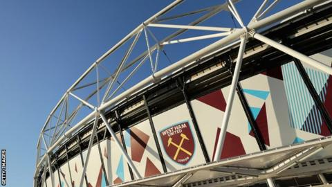 West Ham suspend transfers director over 'African ban' claim