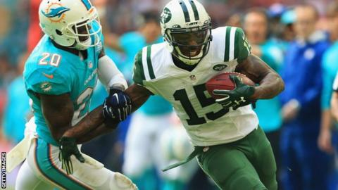 Brandon Marshall of the New York Jets holds off Reshad Jones