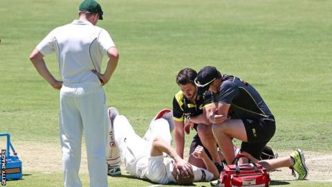 Adam Voges receives treatment after being struck on the head by a bouncer